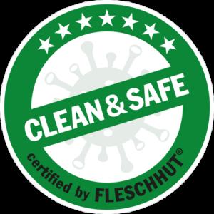 """Siegel mit einem grünen Verbotszeichen, welches einen stilisierten Virus durchschneidet. Darauf steht """"Clean & Safe certified by Fleschhut"""""""